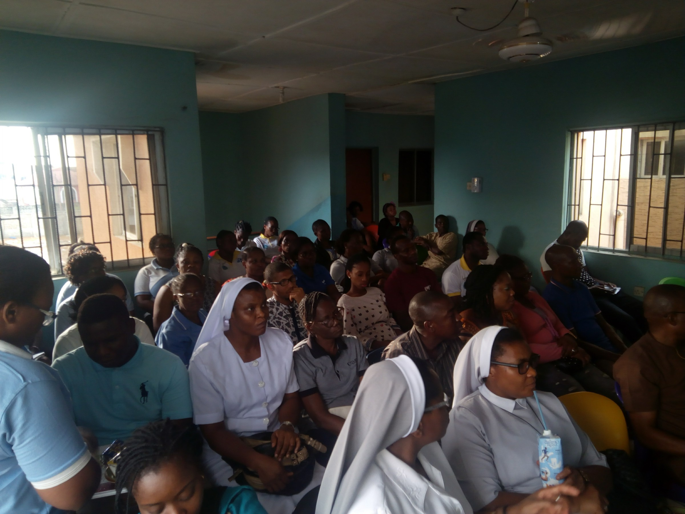 Cross section of members of staff receiving Lecture